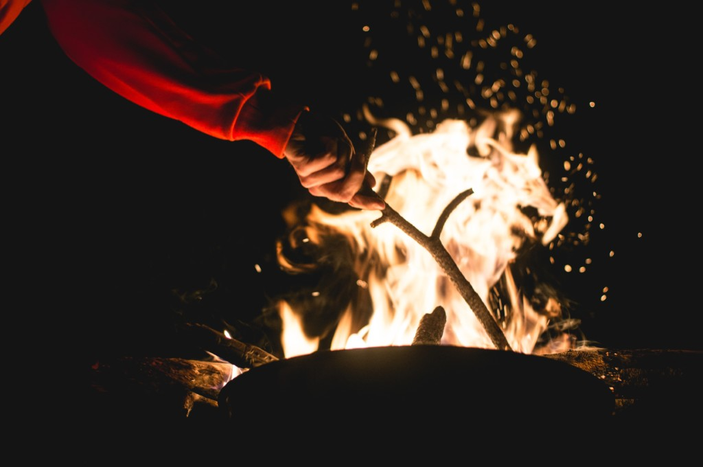 stick stoking fire