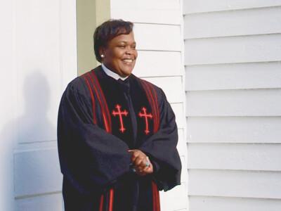 female pastor in robe
